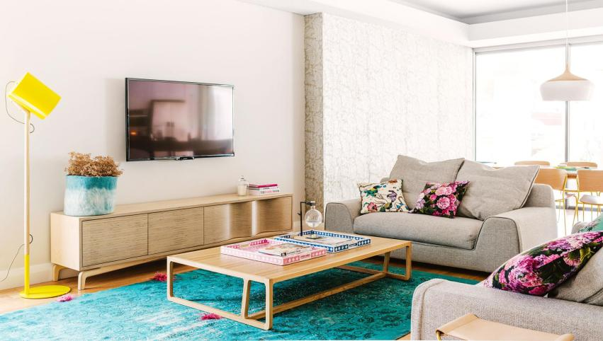 colourful-living-room-yellow-lamp-floral-cushions-rug-timber-coffee-table-apr15-20150407145850~q75,dx1920y-u1r1g0