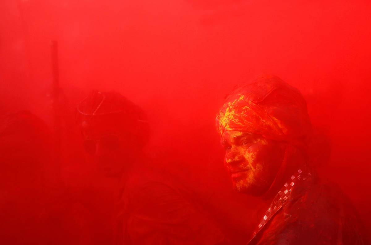 Hindu devotees take part in the religious festival of Holi in Nandgaon